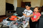 Tyree Walters, 6, unwraps his gift from PlayStation NZ much to the delight of his 3-year-old sister Marli. Photo / John Stone