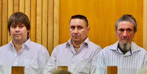 Mathew Thomas Madams, Kevin Roy Madams, and Tyrone Peter Madams in the dock on Thursday in the High Court in Whanganui accused of murdering Craig Rippon.