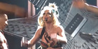 Britney Spear's top comes undone while she performs onstage. Photo / YouTube