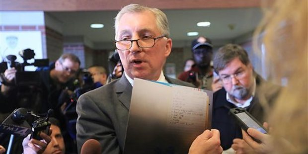 Chris Van Wagner, attorney for Alec Cook, displays an enlarged copy of a notebook page belonging to his client. Photo / AP
