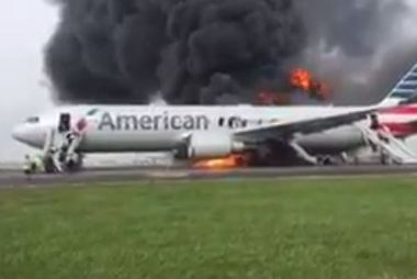 Passengers used emergency chutes to escape the plane.