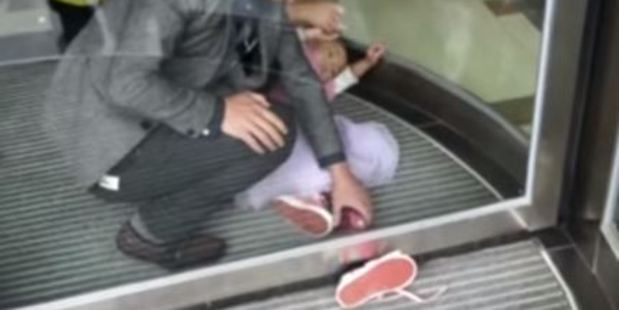 The girl was walking through the revolving doors in a hotel when the incident occurred. Photo / Youtube / CCTV