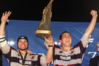 Michael Jones and Paul Thomson hold the trophy aloft after Auckland beat Wellington in the 1999 NPC final. Photo / Getty