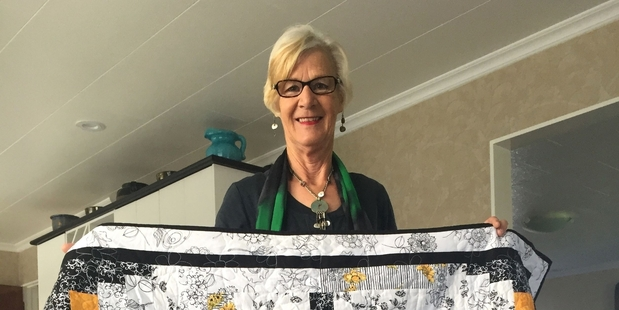 Jennifer Patterson with one of her quilts.
