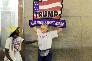 Anti-Trump protester Loris Jones-Randolph, 27, and Trump supporter Elena Rubak, 52, discuss their differences outside Trump Tower.