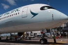 Cathay Pacific's new $400 million A350 flew into Auckland for the first time yesterday but faces a wave of competition this summer.