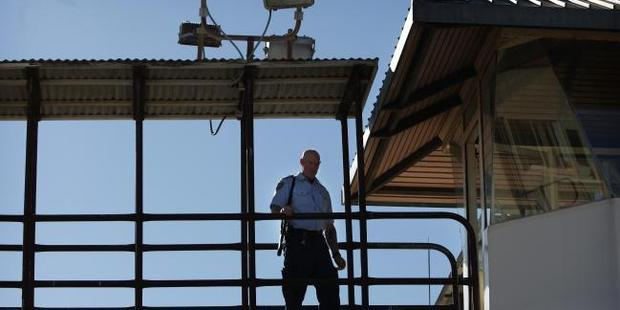 An armed guard in the watch tower at Long Bay prison where Grant Davies may spent most of the next 18 years of his jail sentence. Photo / News Corp