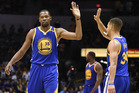 Golden State Warriors forward Kevin Durant, left, high-fives Stephen Curry. Photo / Ap