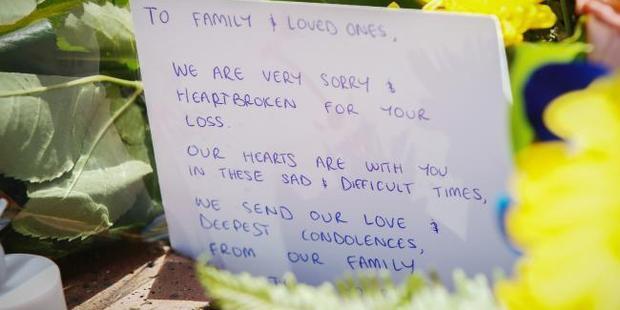 Cards and flowers outside Dreamworld. Photo / Nigel Hallett, News Corp Australia