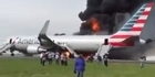 Watch: Watch: Dramatic scenes as plane catches fire at Chicago airport
