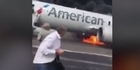 Watch: Watch: Passengers flee burning jet in Chicago