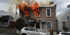 Firefighters have managed to contain a blaze at a large house in Carroll Street, Dunedin. Photo / Otago Daily Times