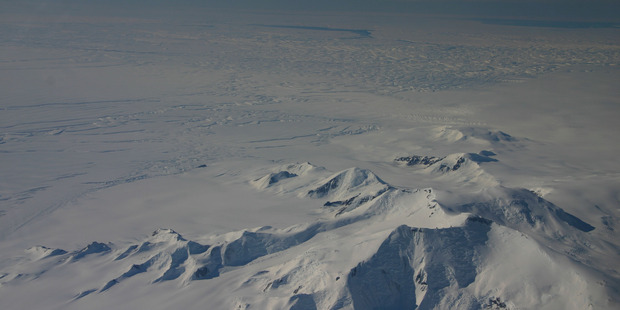 Part of the eastern flank of Crosson Ice Shelf (centre left) and Mt Murphy (foreground) as viewed during a Nasa flight in 2012. Thwaites Ice Shelf lies beyond the ice (centre). Photo / Nasa.
