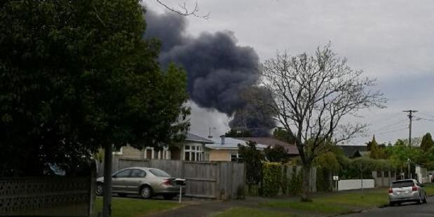 Smoke can be seen billowing across the city. See here from Gillies Ave, Claudelands. Photo / Supplied