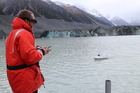 Canterbury University geography technician Paul Bealing operates a miniature high-tech jet boat used to investigate Lake Tasman in the South Island. Photo: Heather Purdie