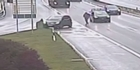 Watch: Watch: Man chases own car down busy motorway on foot