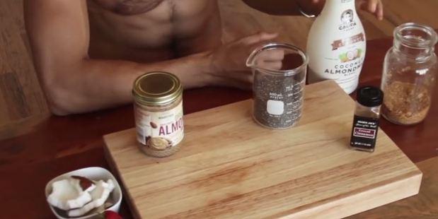Franco talks through his key ingredients, sans shirt. Photo / YouTube, Franco Cooks