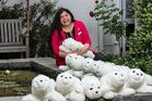 Orquidea Tamayo Mortera, Selwyn's divisional therapist, with the colony of PARO therapeutic seal robots.