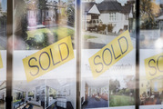 A looming decline in cashed-up Asian property buyers has prompted real estate agents to urge locals to sell up while they still have the chance to make big money.