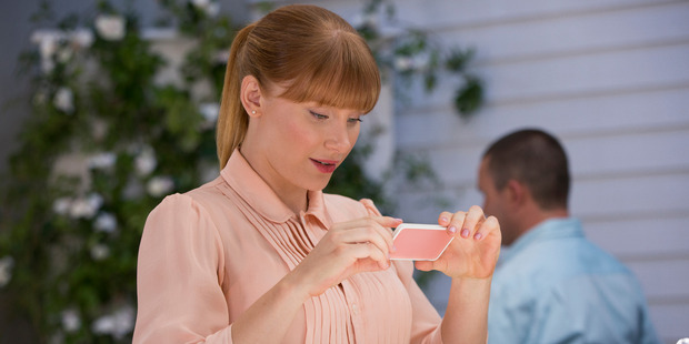 Lacie (Bryce Dallas-Howard) takes a photo of her latte . Photo / Netflix.
