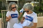 Clinton campaign volunteers Amy Arlein, left, and Susan Lemkin check the list of houses they have to visit in West Palm Beach, Florida. Photo/Chris Reed