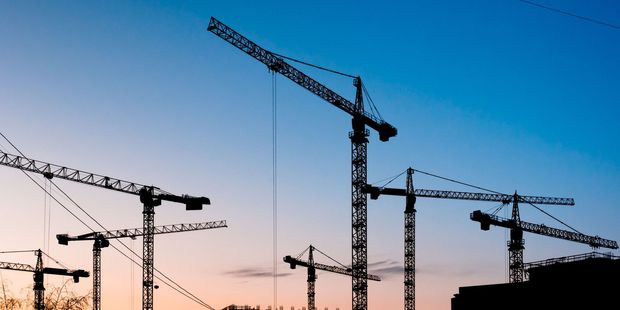 Cranes are crowding the skylines as Australia's biggest cities head toward apartment oversupply. Photo / 123rf