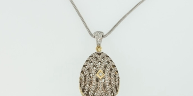 SPARKLING LOT: This gold, platinum and diamond egg pendant is up for auction at The Hawke's Bay Wine Auction.