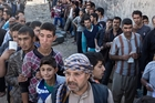 Residents queue for aid packages in Gogjali, on the eastern edge of Mosul, after Isis fighters were pushed out of the eastern edge of the city. Photo / AP