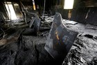 Burned pews, destroyed musical instruments, Bibles and hymnals are part of the debris inside the fire damaged Hopewell M.B. Baptist Church in Greenville, Mississippi. Photo / AP