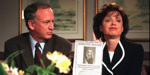 John and Patsy Ramsey hold up a poster for information on who murdered their 6-year-old daughter. Photo / AP