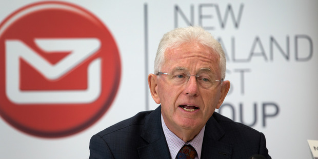 New Zealand Post Group chairman Sir Michael Cullen announcing the company's decision to sell off part of Kiwibank during a press conference in Wellington. Photo / Mark Mitchell