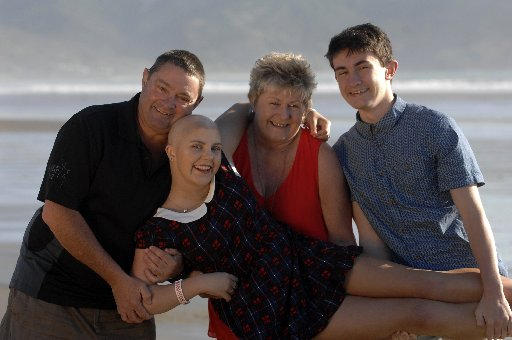 Georgia Buckingham enjoying a day at Ahipara with her dad Glenn (left), mum Jo and brother Trent.