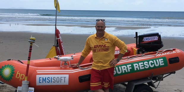 """Surf Life Saving New Zealand national lifesaving manager Allan Mundy with a drone and GPS-tracking """"drifter"""" being used in a series of rip current surveys this summer. Photo: Supplied"""