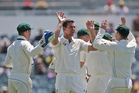 Australia's Josh Hazlewood (center) celebrate with his team after taking the wicket of South Africa's Hashim Amla for a duck. Photo / AP
