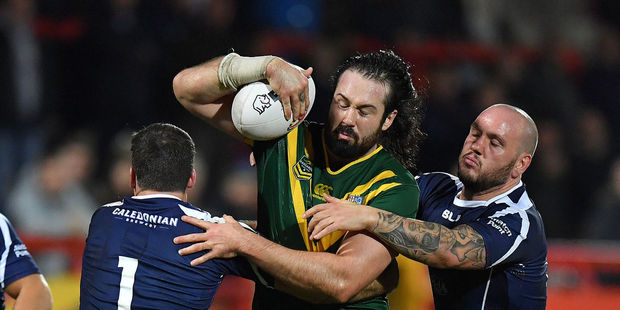 Australia's Aaron Woods looks to evade the tackles of Lachlan Coote and Dale Ferguson in the Kangaroos' recent 54-12 win over Scotland in Hull. Photo / Photosport