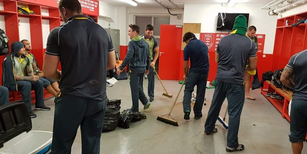 Kangaroos players sweep out their change room following their 54-12 Four Nations win over Scotland. Photo / Twitter.