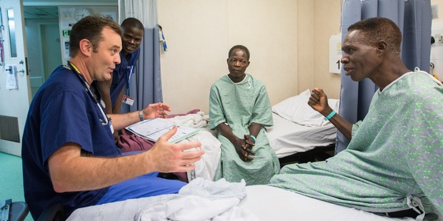 HEARTFELT: Hastings' Dr Tony Diprose visits a patient during his mission to West Africa. PHOTO KATIE CALLOW