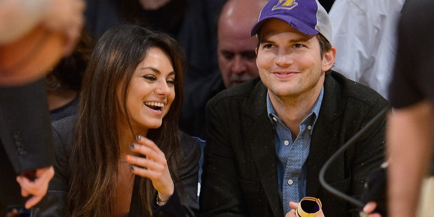 Ashton Kutcher (R) and Mila Kunis attend a basketball game between the Utah Jazz and the Los Angeles Lakers at Staples Center on January 3, 2014. Photo / Getty