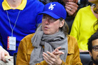 Val Kilmer, seen here attending a 2014 basketball game, has denied reports he's battling cancer. Photo/Getty