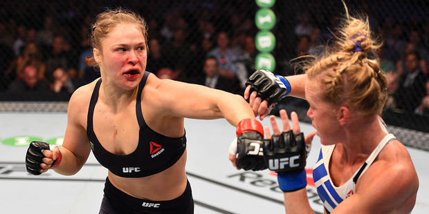 Ronda Rousey punches Holly Holm in their UFC women's bantamweight championship bout at UFC 193. Photo / Getty