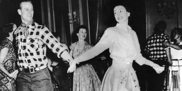 The Duke of Edinburgh dances with his wife, Princess Elizabeth, at a square dance held in their honour in Ottawa, by Governor General Viscount Alexander, 17th October 1951. Photo / Getty