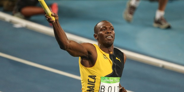 Usain Bolt celebrates victory after the Men's 4 x 100m Relay Final at the Rio Olympics. Photo / Getty Images