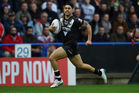 Shaun Johnson runs in to score a try during the Four Nations match between England and New Zealand. Photo / Getty