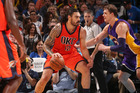 Steven Adams handles the ball against the Los Angeles Lakers. Photo / Getty Images
