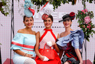 Myer Fashions on the Field Women's Racewear competition - Olivia Moor and Runners Up Yvette Hardy and Charlotte Moor pose on Emirates Melbourne Cup Day. Photo / Getty Images