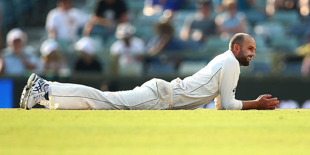 Nathan Lyon of Australia lies on the pitch at the WACA. Photo / Getty