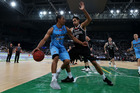 Mika Vukona is guarded by former teammate Tai Wesley in the Breakers' encounter with Melbourne. Photo / Getty