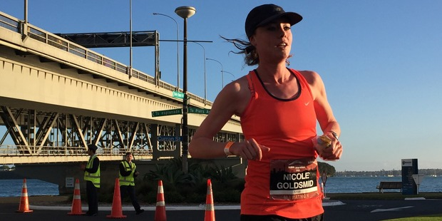 Nicole Goldsmid was first over the Harbour Bridge and went on to win the women's marathon. Photo / Greg Bowker