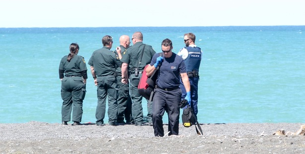 Emergency services gather at Marine Parade where a body was found in the water.