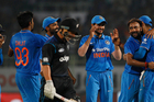 India's Amit Mishra celebrates with teammates after taking the wicket of New Zealand's BJ Watling.